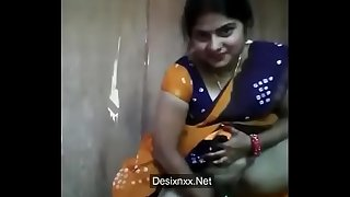 Hot nd sexy married desi bhabhi in saree masturbating her hairy wet pussy with cucumber as dildo on cam WITH AUDIO